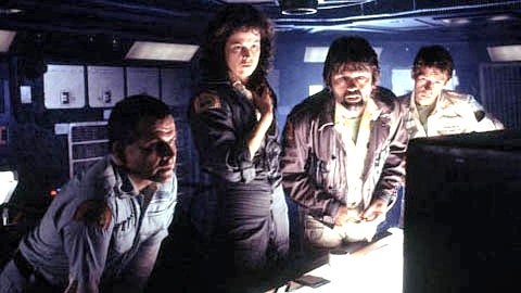 PLAGUED BY AN ALIEN. Ash (Ian Hom), Ripley (Weaver), Dallas (Skerritt), and Kane (John Hurt) confer about the transmission.