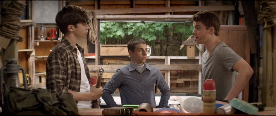 PLAYING HOUSE. Joe, Biaggio and Patrick plan how they will survive in the jungle after they finish their rickety abode.