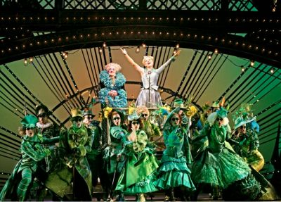 GREEN IS IN. Ozians cheer for Glinda the Good in one of the bigger production numbers of the show. (credit to the owner of this image)