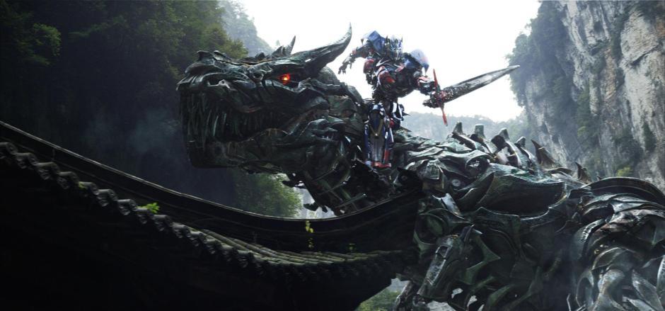 DINOBOTS. Optimus Prime rides Grimlock into battle.